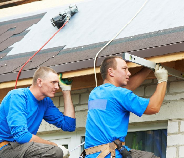 A team of roofers repairing a roof in Allentown, PA
